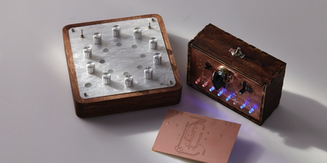 Circuit board and electronic enclosure made from pearlescent acrylic and baltic birch