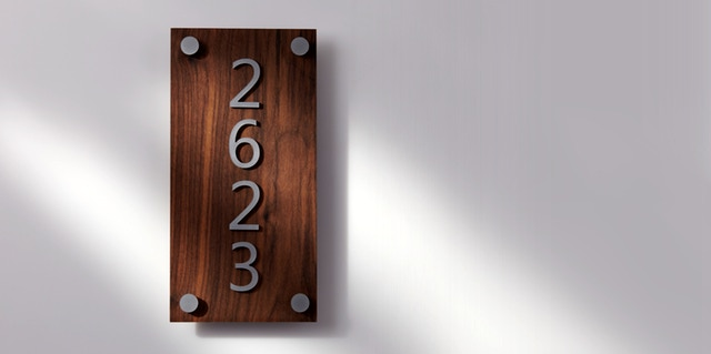 Address sign made from walnut and silver metallic acrylic sheet