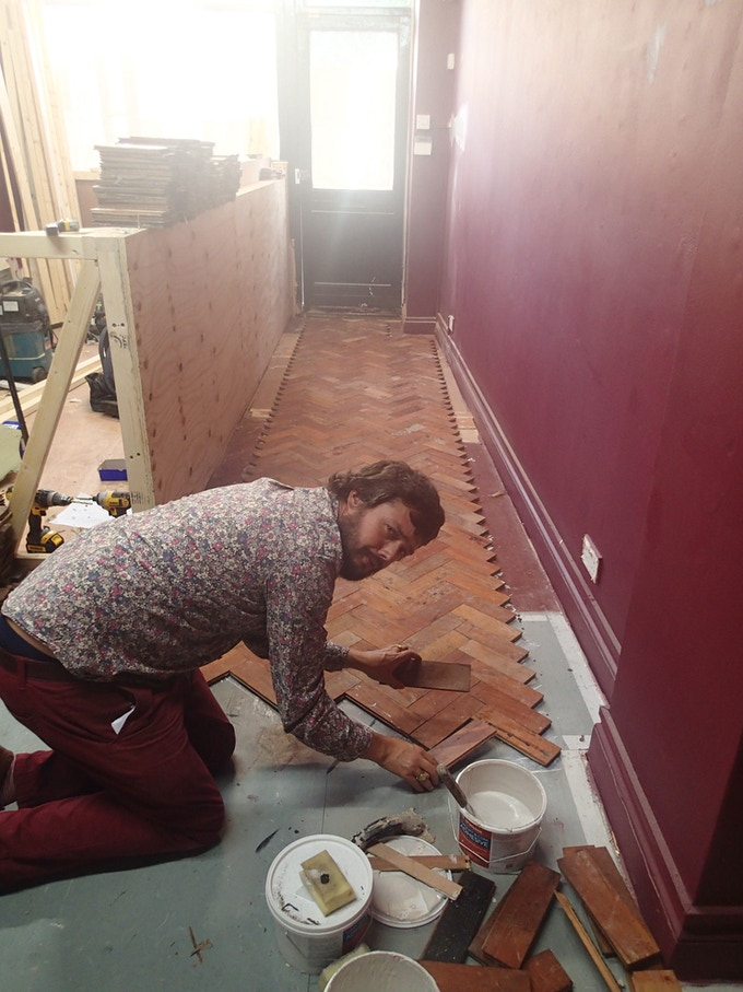 laying the reclaimed parquet floor