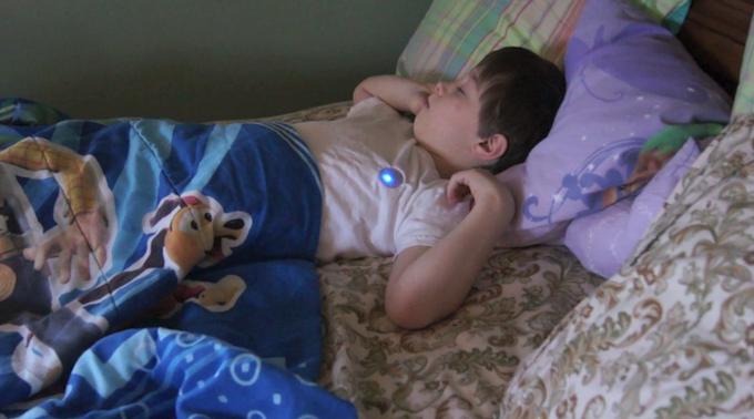 A CHILD SLEEPING WITH MONBABY SLEEP ANALYZER
