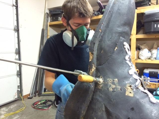 Michael making fiberglass repairs to a broken foot