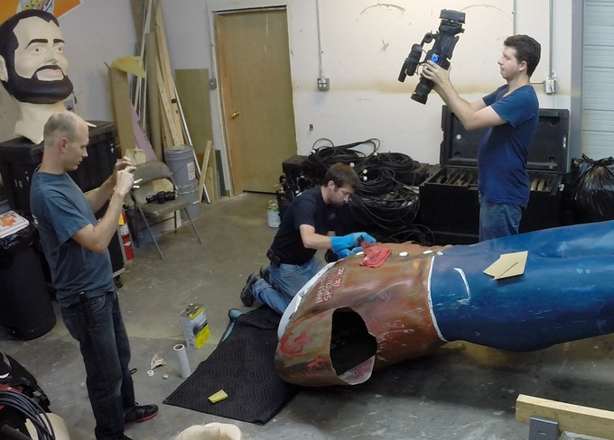 The American Giants Team documents the discovery of hidden lettering on the Muffler Man
