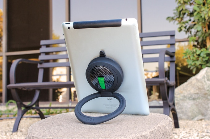 The Limited Edition SpinPadGrip features a bright green locking tab and carbon fiber base.