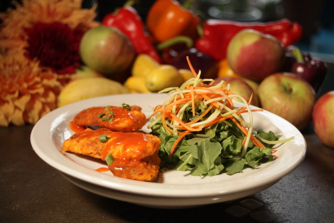 Black Bean HEMPEH buffalo wings with arugula salad. | Chef Jeff Chandler of Overeasy Café | Photo by Daniel Judson