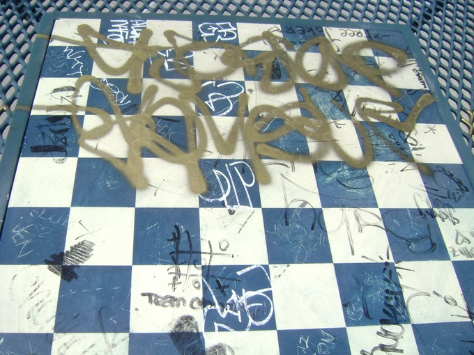 vandalized checkerboard picnic table