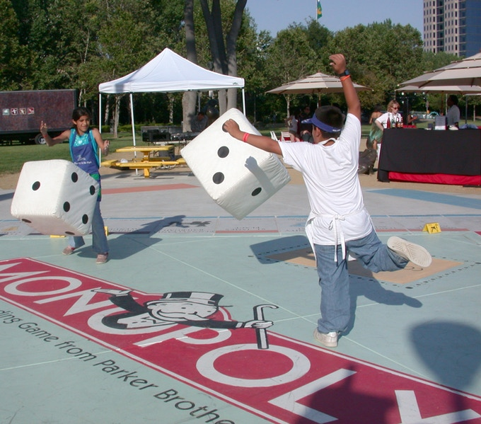 Children love to play with giant dice and other large game pieces.