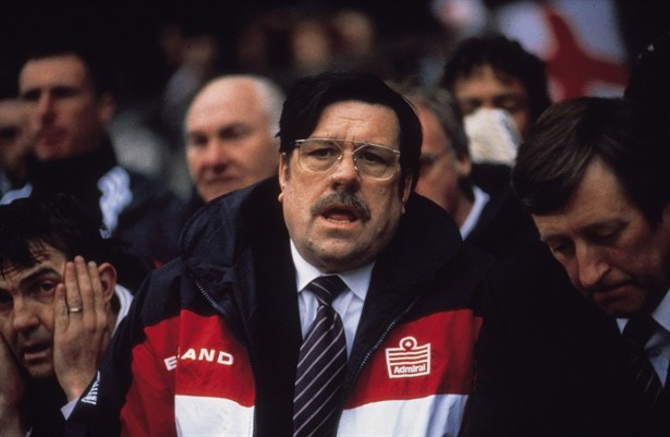 Ricky Tomlinson as Bassett in the original film