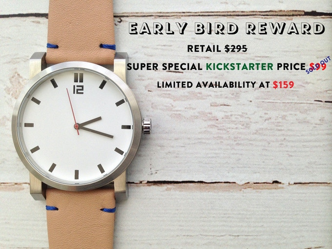 White dial, natural tan leather strap with blue stitiching.