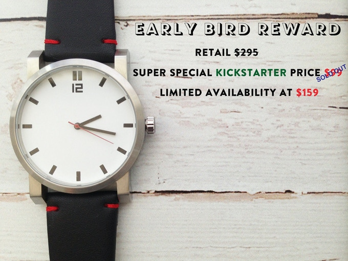 White dial, black leather strap with red stitching.