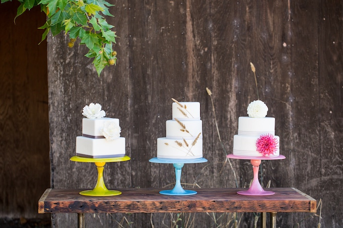 A few of our cakes displayed on custom cake stands in front of the future Wind & Rye Kitchen.  Photo by Kate Webber