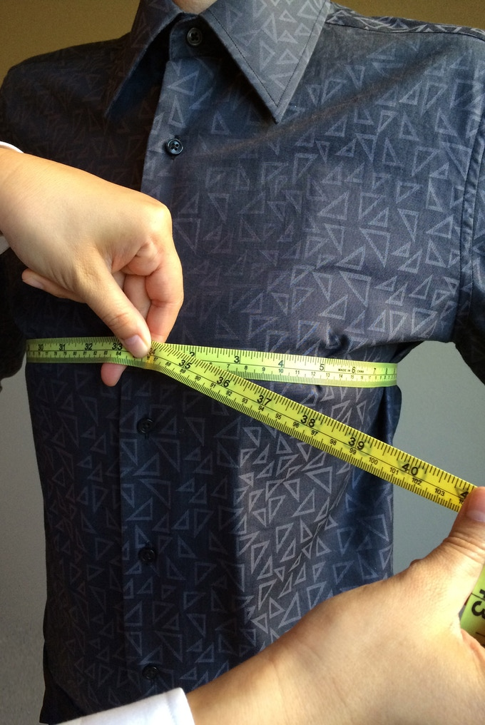 Measure around the largest part of the bust with two finger allowance.