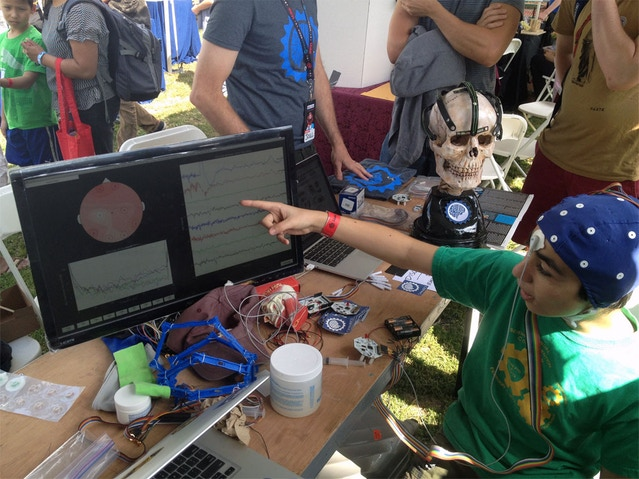 Sid seeing his own brain waves for the 1st time w/ OpenBCI at World Maker Faire NYC