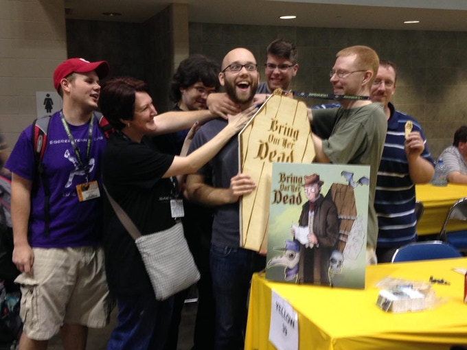 All the finalists of our GenCon tournament went home with a coffin keychain, but the winner got the Deluxe Coffin game case. Needless to say, they all wished him well!