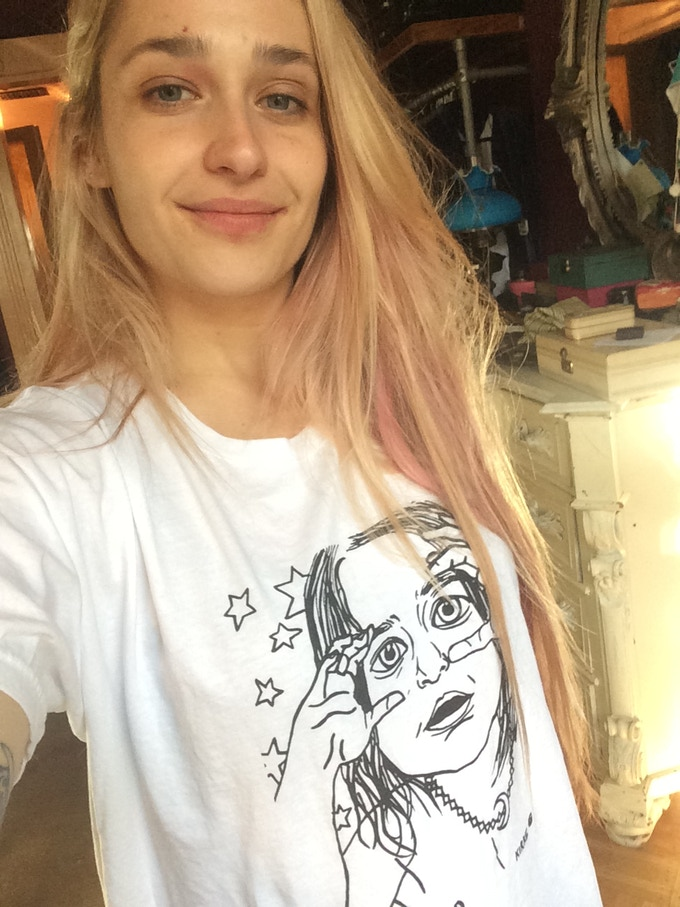 Jemima Kirke wearing her LSG COLOR OUTSIDE THE LINES t-shirt featuring her incredible drawing!