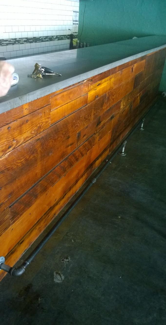 Our lovely bar, awaiting soda fountain stools.