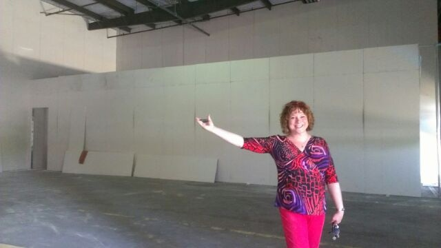 Lisa in the new space just after construction began