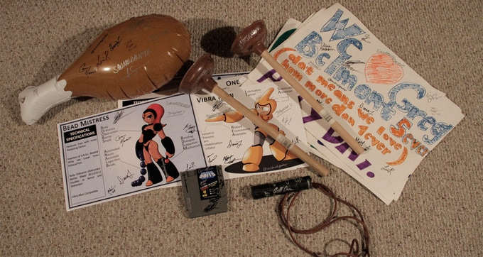 Screen Used Props from Living in 8 Bits Autographed by Members of the Cast