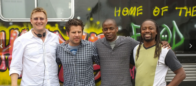 """David directing """"Shawn and Gus Truck Things Up"""" from Season 8 of PSYCH.  Pictured here with James Roday, Dulé Hill and Saladin K. Patterson."""