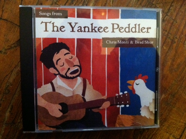 "The cover of ""The Yankee Peddler"" the soundtrack of the children's puppet show performed by Brad Shur and I. Released 2013."