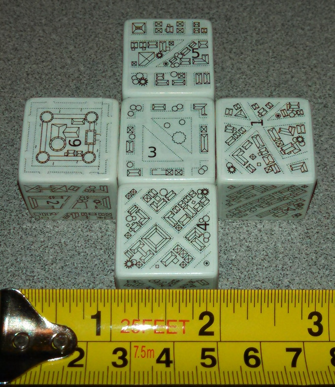 This picture shows mockups of new city dungeonmorph dice. (Stickers on other dice--the real dice will be engraved.) The logo graphic shows dice with city & village designs.