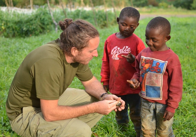 Dr. Jared Wolfe teaching Equatoguinean schoolchildren about the value of birds.