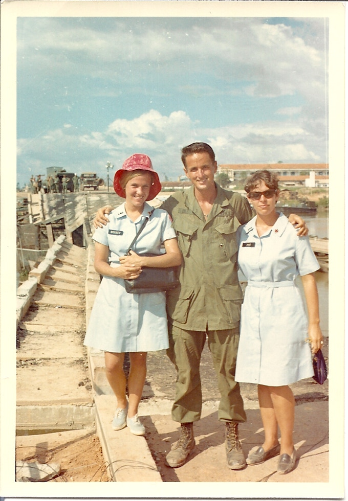 Donut Dollies Dorset Hoogland and Judy Pence with a happy soldier (name not known... yet)