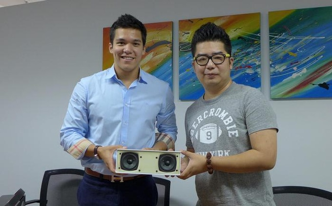 Tommy (founder, left) & Hudson (engineer, right) holding the first JookBox.