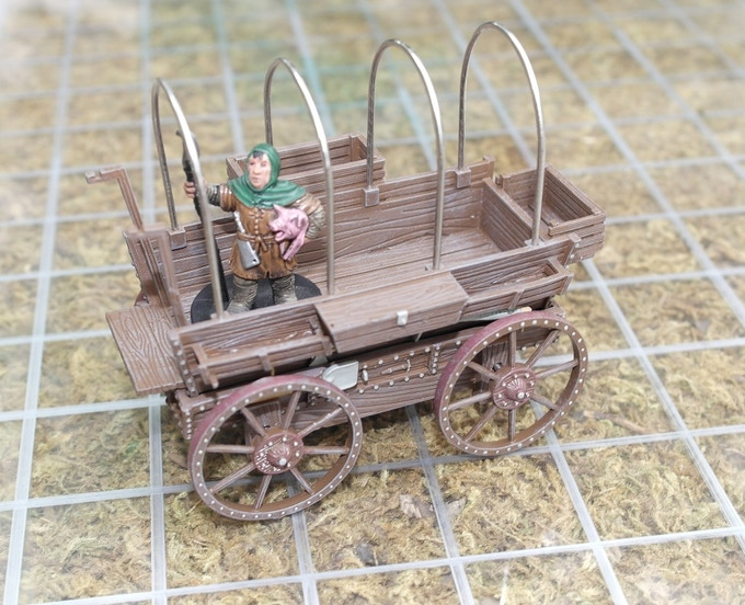 Without the cover, the wagon reveals space enough to hold up to four 28mm miniatures, with one riding on the wagon seat.