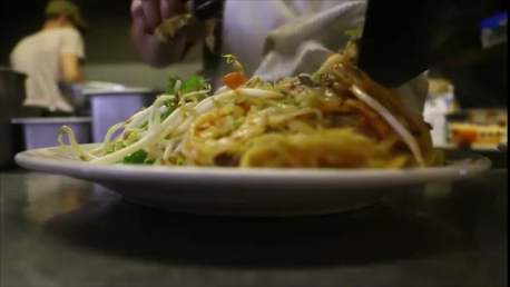 Pad Thai - rice noodles, egg, lots of shredded veg and bean sprouts in a lightly tangy sweet sauce with chicken, shrimp or tofu