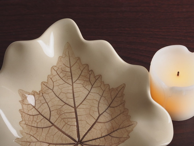 Intricate leaf detail captured and highlighted on the stoneware