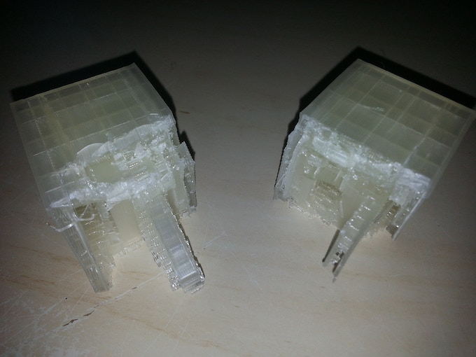 """Two halves of the first 3D printed device, in-filled by 3D """"support"""" material, resulting in a block of corn-based plastic"""