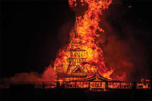 The same temple on fire. Photo by Philip Volkers.