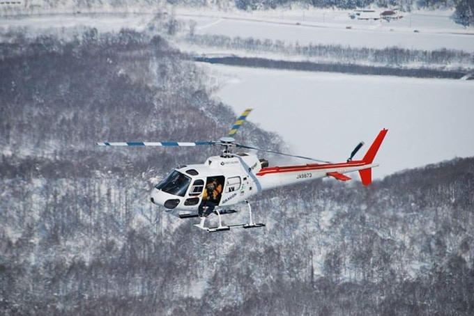 Warren Miller Entertainment shooting aerial video on Hokkaido near Black Diamond Lodge in 2014