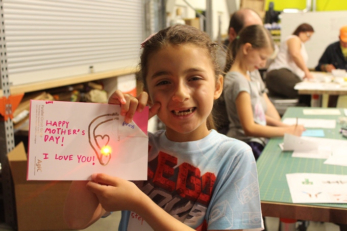 Girl with a Mother's Day card she made easily with Circuit Marker (taken by the Tech Museum of Innovation)