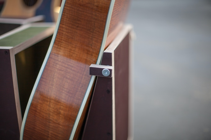 Guitar only touches on the binding, also seen our patiented guitar stablizer