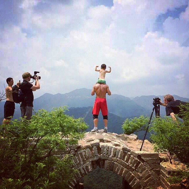 Chris and David filming TUF Featherweight Champion Ning Guangyou and son atop the Great Wall
