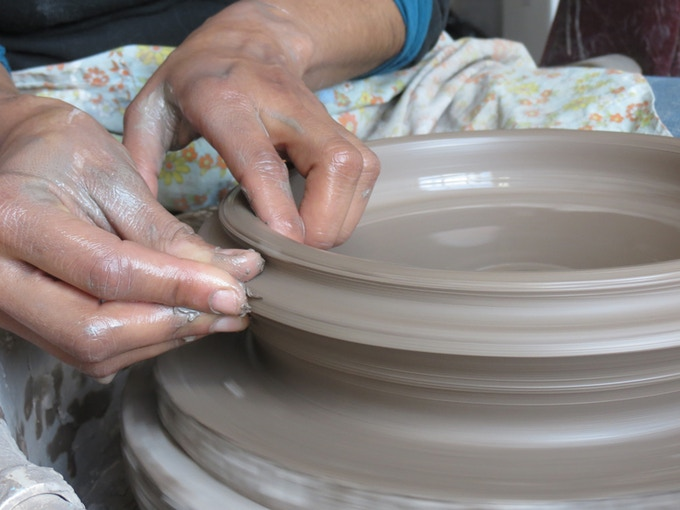 HCC Student throwing a vessel