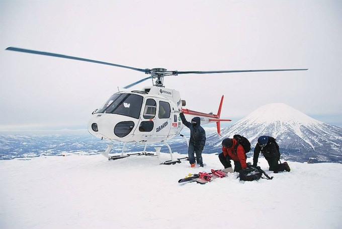 The crew from Dragon Helicopter and Black Diamond Lodge landing on Shiribetsu-Dake in Hokkaido.