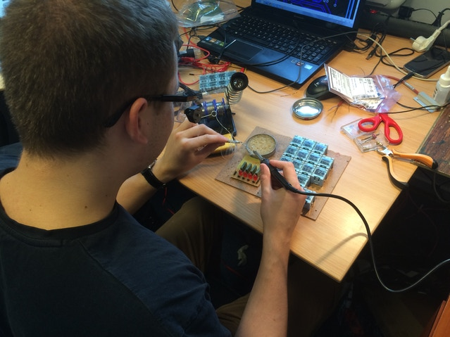 Damian soldering the battery tester for the NeuroOn