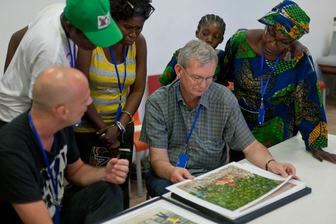 Martin Parr conducts a portfolio review at LagosPhoto 2013.