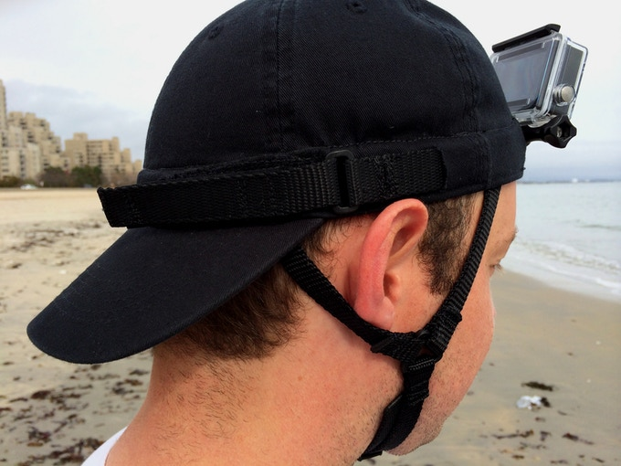 An adjustable head strap is connected to the GoPro mounting bracket