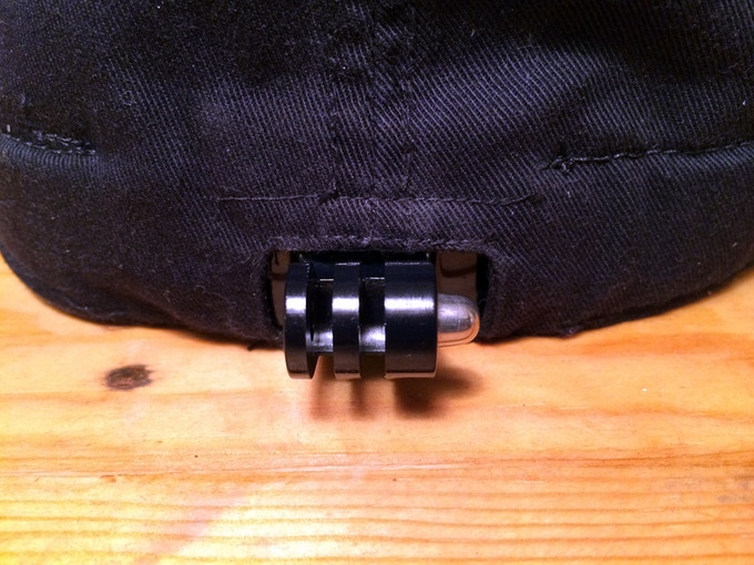 The GoPro mounting prongs exit the back part of the hat