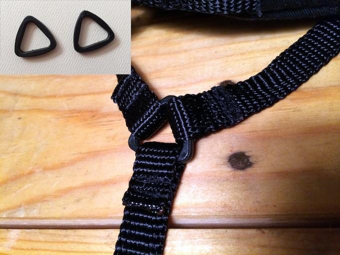 Plastic tri-loops connect the nylon chin straps