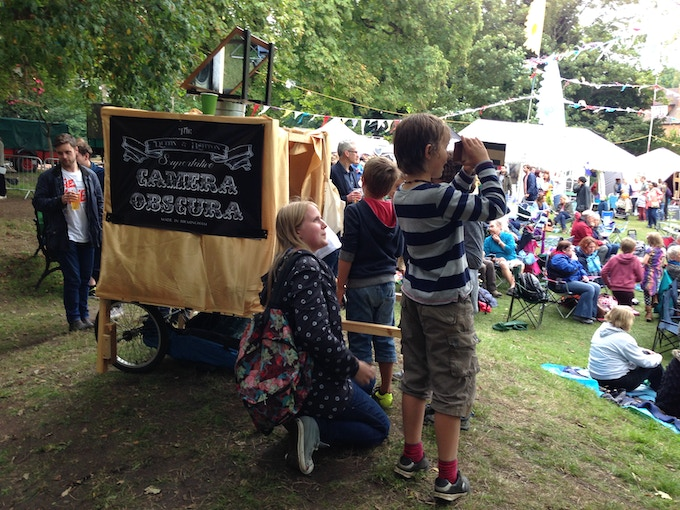 Jenny showing children how the camera obscura works at Moseley Folk Festival.