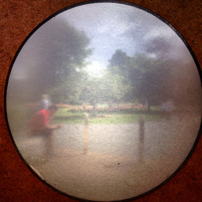 A photo of the screen in a mini camera obscura, taken with a cameraphone.
