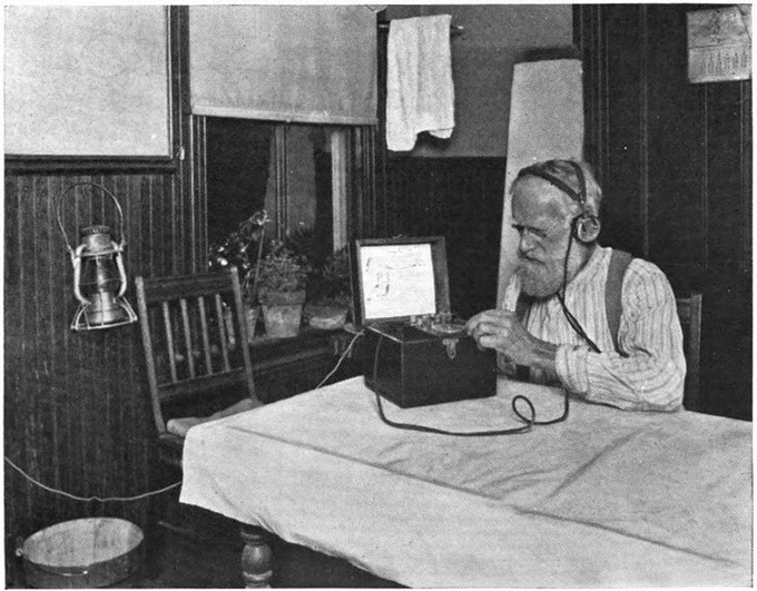 Farmer with early radio set.