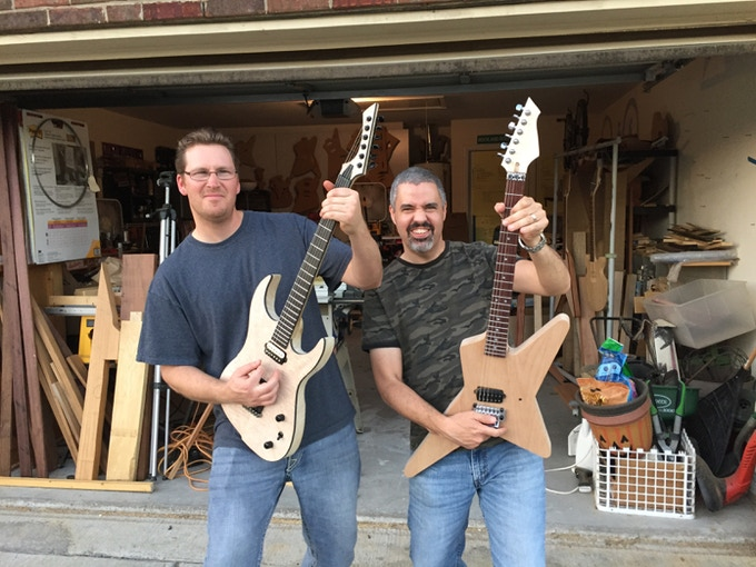 Brandon and Michael with the guitars they built in class