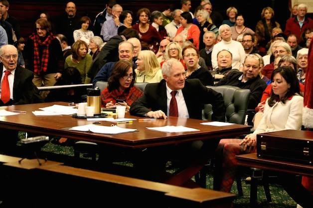Attorneys Jack Casey and Molly Casey sit with their party, Diane Dorring, a distant relative of Major Henry Livingston Jr. Retired Judge John T. Casey left. (Photo by Mark Fallon).