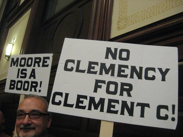 Gregg Stacy from Brown's Brewing Co. holds signs in support of the Livingston authorship claim.  (Photo by Carol Reid.)
