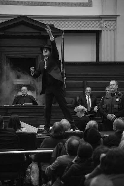 """Even gangster Jack """"Legs"""" Diamond gets into the holiday spirit by showering the courtroom with chocolate gold coins. (Photo by Tonya Scanlon Massey.)"""